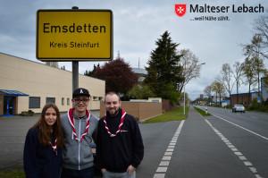 Lebacher Malteser vor dem Ortsschild von Emsdetten